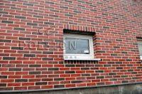Фото отделки окна кирпичом, баварская кладка облицовочного кирпича ГРАНАТ
